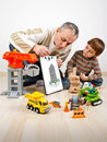 Family father boy build toys Stock Photo
