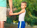 Family father man and son boy child holding hand in hand outdoor happiness emotion with summer nature on background Royalty Free Stock Image