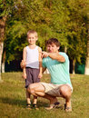 Family father man and son boy child playing outdoor happiness emotion with summer nature on background Stock Image