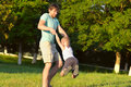 Family father man and son boy playing outdoor park flying round happiness emotion with summer nature on background Royalty Free Stock Photography