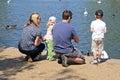 Family feeding ducks, Stratford-upon-Avon. Royalty Free Stock Photo