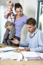Family with financial problems kids discussing no work lots of bills Stock Photos
