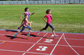 Family fitness, mother and kids running on stadium track, training and children sport healthy lifestyle Royalty Free Stock Photo