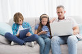 Family focus on wireless technology Royalty Free Stock Photo