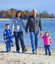Family of four at the beach Stock Photography