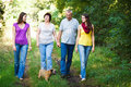 Family of four with a cute dog outdoors Royalty Free Stock Photos