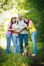Family of four with a cute dog outdoors Stock Photography