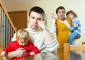 Family of four having quarrel at home young people in living room Royalty Free Stock Images