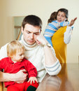Family of four having quarrel il leaving room Royalty Free Stock Photo