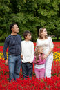 Family of four looking aside in flowering park Royalty Free Stock Image