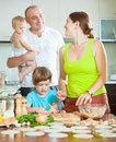 Family of four making these dumplings stuffed with fish and doug happy dough Stock Photography
