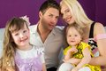 Family of four in the purple room portrait a Royalty Free Stock Photography