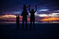 Family of four silhouette in the sunset on the beach boracay this image has attached release Royalty Free Stock Photography