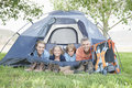 Family of four smiling in tent portrait a from a Royalty Free Stock Photography