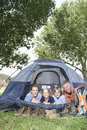 Family of four smiling in tent portrait a from a Royalty Free Stock Photos