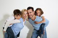 Family of four standing on white background Stock Photography