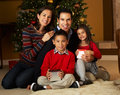 Family In Front Of Christmas Tree Stock Photos