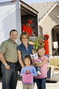Family in front of delivery van and house portrait a four standing a Royalty Free Stock Photo