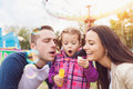Family at fun fair Royalty Free Stock Photo