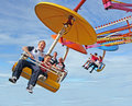 Family fun on fairground ride photo of families riding high the umbrella at whitstable in kent photo ideal for leisure activity Royalty Free Stock Photo