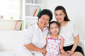 Family generations happy asian at home grandparent parent and grandchild sitting on sofa smiling looking at camera Royalty Free Stock Images