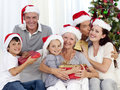 Family giving presents for Christmas Royalty Free Stock Photos