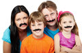Family with glued artificial mustaches. Stock Images