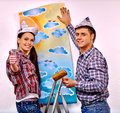 Family glues wallpaper at home happy Stock Photography