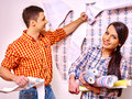 Family glues wallpaper at home happy colors Stock Images