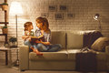 Family before going to bed mother reads to her child daughter bo Royalty Free Stock Photo