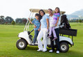Family with a golf cart Royalty Free Stock Photo