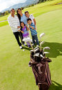 Family at a golf field Stock Photo