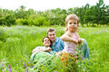 Family in grass Royalty Free Stock Photo