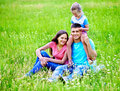 Family on green grass. Stock Image