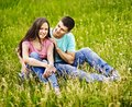 Family on green grass happy couple outdoor Royalty Free Stock Images