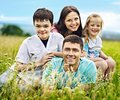 Family on green grass happy outdoor Stock Photos