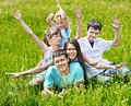 Family on green grass happy outdoor Royalty Free Stock Image