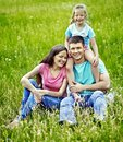 Family on green grass happy outdoor Royalty Free Stock Photos