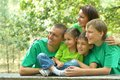 Family in green jersey resting the is a summer park Royalty Free Stock Image