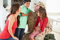 Family greeting military father home on leave smiling to each other Royalty Free Stock Photography