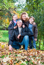 Family Group Relaxing Outdoors In Autumn Landscape Stock Images