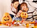 Family on halloween party with children making carved pumpkin Stock Image