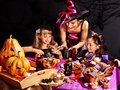 Family on halloween party with children making carved pumpkin Royalty Free Stock Images
