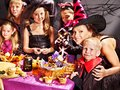 Family on halloween party with children making carved pumpkin Royalty Free Stock Image