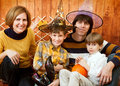The family with halloween symbols against a wooden wall Royalty Free Stock Images