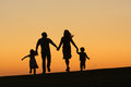 Family happy running together at sunset Stock Photography