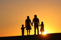 Family happy together at sunset Royalty Free Stock Images