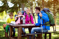 Family have a break from hiking Royalty Free Stock Photo