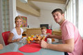 Family have healthy breakfast at home happy young kitchen with red details on bright morning light Stock Photos