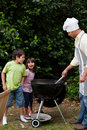 Family having a barbecue in the garden Royalty Free Stock Photos